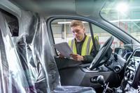 Apprentice vehicle inspector inspecting interior of vehicle in car factory 11015313095| 写真素材・ストックフォト・画像・イラスト素材|アマナイメージズ