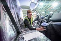 Apprentice vehicle inspector inspecting interior of vehicle in car factory 11015313096| 写真素材・ストックフォト・画像・イラスト素材|アマナイメージズ