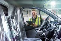 Apprentice vehicle inspector inspecting interior of vehicle in car factory, portrait 11015313097| 写真素材・ストックフォト・画像・イラスト素材|アマナイメージズ