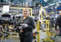 Female apprentice engineer on production line in car factory, portrait 11015313103| 写真素材・ストックフォト・画像・イラスト素材|アマナイメージズ