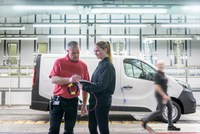 Female apprentice engineer with mentor on production line in car factory 11015313106| 写真素材・ストックフォト・画像・イラスト素材|アマナイメージズ