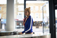 Woman going through security barrier on arrival at work 11015313569| 写真素材・ストックフォト・画像・イラスト素材|アマナイメージズ