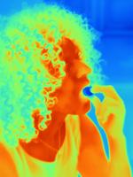 Thermal image portrait of mid adult woman eating 11015325314| 写真素材・ストックフォト・画像・イラスト素材|アマナイメージズ
