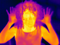 Thermal image portrait of mid adult woman with raised hands 11015325319| 写真素材・ストックフォト・画像・イラスト素材|アマナイメージズ