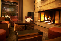 Portrait of man relaxing in armchair by log fire in hotel lounge, Aspen, Colorado, USA 11015326219  写真素材・ストックフォト・画像・イラスト素材 アマナイメージズ