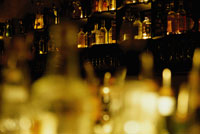barglasses and bottles at night