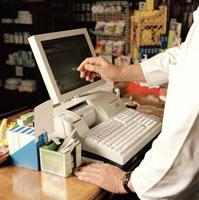 Pharmacist pointing at cash register