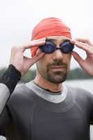 Man adjusting swimming goggles