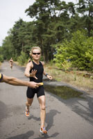 Woman reaching for wet sponge in race