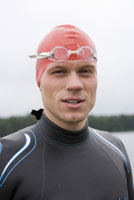 Triathlete with swimming goggles and cap