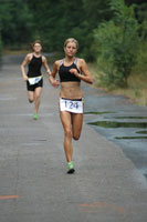 Young woman competing in triathlon