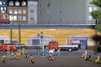 Model of soccer match near railway track
