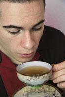 Young rockabilly man drinking tea