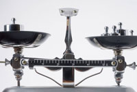 Close-up of balance scales with weights