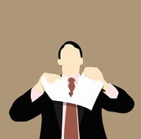 A businessman tearing up a document