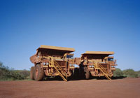 Two large dump trucks side by side