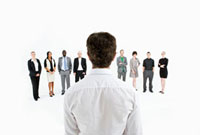 A man standing in front of a row of business people