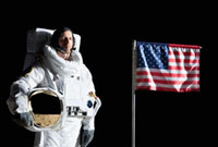 An astronaut holding his helmet standing next to an American 11016020157| 写真素材・ストックフォト・画像・イラスト素材|アマナイメージズ