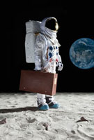 An astronaut on the moon carrying a suitcase