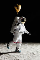 An astronaut on the moon holding a heart shaped helium ballo