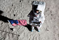 An astronaut on the surface of the moon next to an American