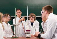 A teacher showing his students a chemistry experiment
