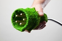 Energy saving power cable covered in green grass