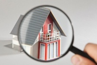 A model house viewed through a magnifying glass