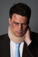 A businessman wearing a neck brace 11016021429| 写真素材・ストックフォト・画像・イラスト素材|アマナイメージズ