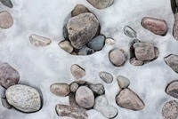 Patterns formed by ice over pebbles