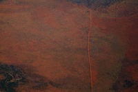 Aerial view of a dirt road positioned in a remote landscape