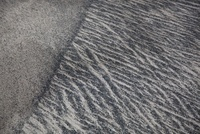 Patterns in the sand, close-up, full frame