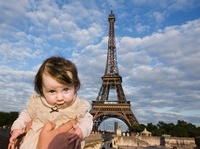 A baby being held aloft in front of the Eiffel Tower, Paris,