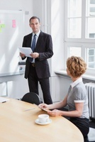 A businessman leading a meeting