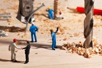 A diorama of a miniature construction site, foreman shaking