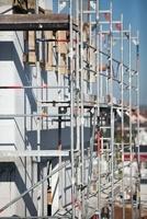 A tilt-shift shot of scaffolding on a building under constru