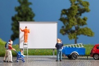 A diorama of a miniature worker billboard posting