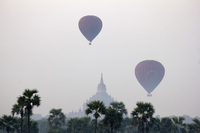 Hot air balloons in the sky of Bagan, temple in the backgrou