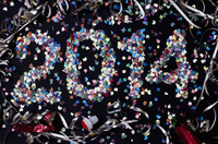 The year 2014 spelled out with confetti and surrounded by st