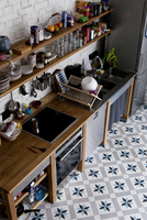 A tidy domestic kitchen with flooring that has a star shaped
