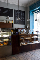 A clean and tidy coffee shop ready for customers