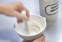 Pharmacist mixing skin cream
