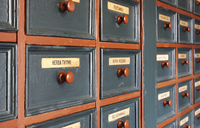 Rows of drawers of homeopathic herbs with 'Herba Thymi' (Thy