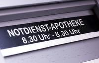 Sign reading 24 hour 'Emergency-Pharmacy' in German