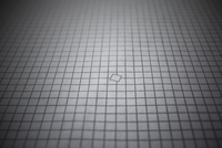 Rows of squares making up a grid, with a single square out o