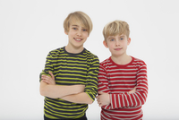 Portrait of boys against white background