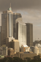 View of tall office buildings against cloudy sky, Sydney, Australia