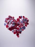 Velvet heart shapes over gray background