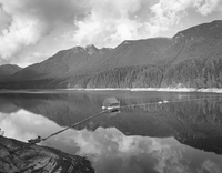 Scenic view of Capilano Lake with mountains in background, Cleveland Dam, British Columbia, Canada