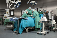 Doctors and nurses operating on a patient in a operating room